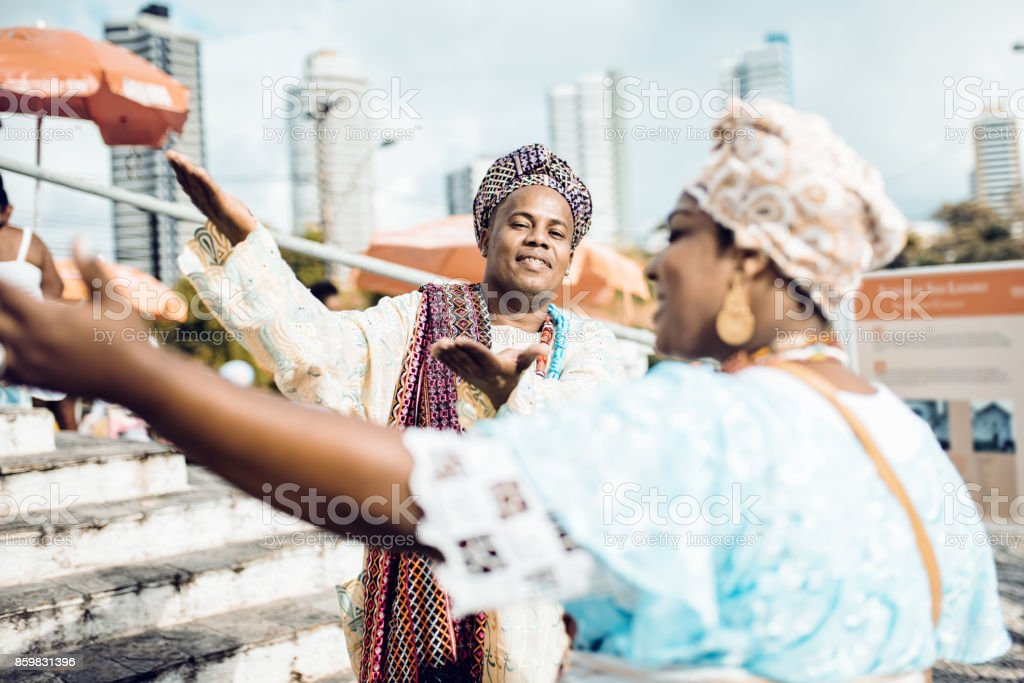 baiana and baiano in traditional costume at religious ceremony in Salvador stock photo