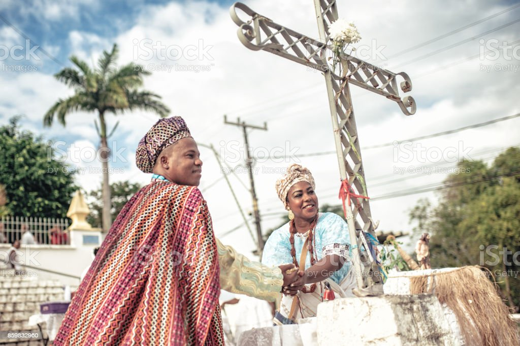 baiana and baiano in traditional costume doing religious ceremony in Salvador stock photo