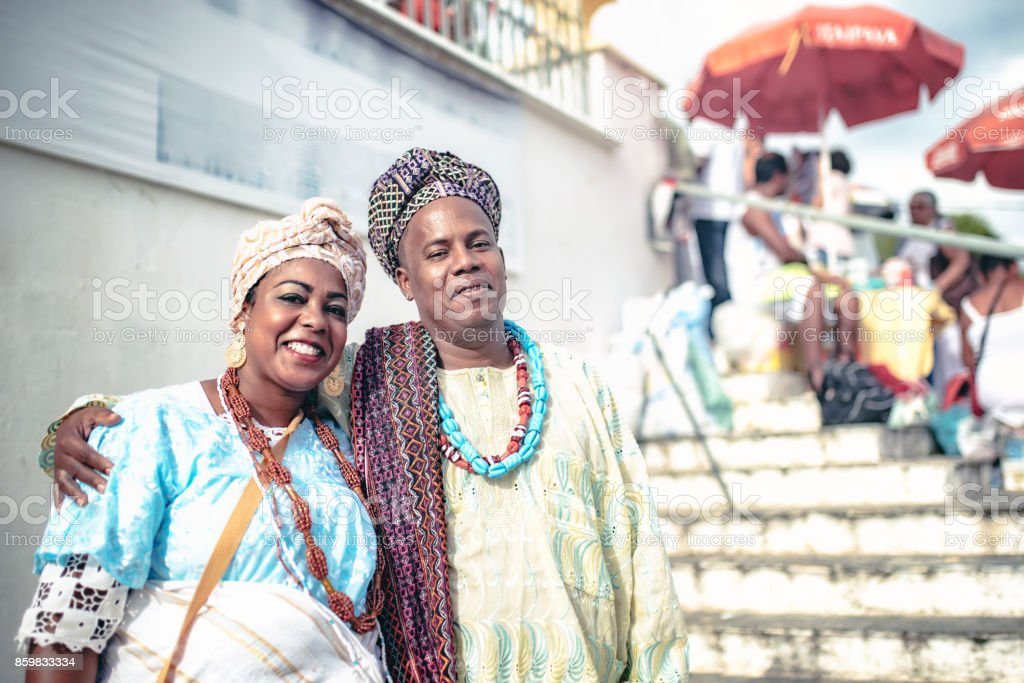 baiana and baiano in traditional costume in front of church in Salvador stock photo