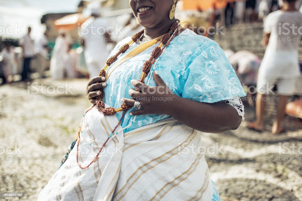 baiana in traditional colorful costume in front of church in Salvador stock photo