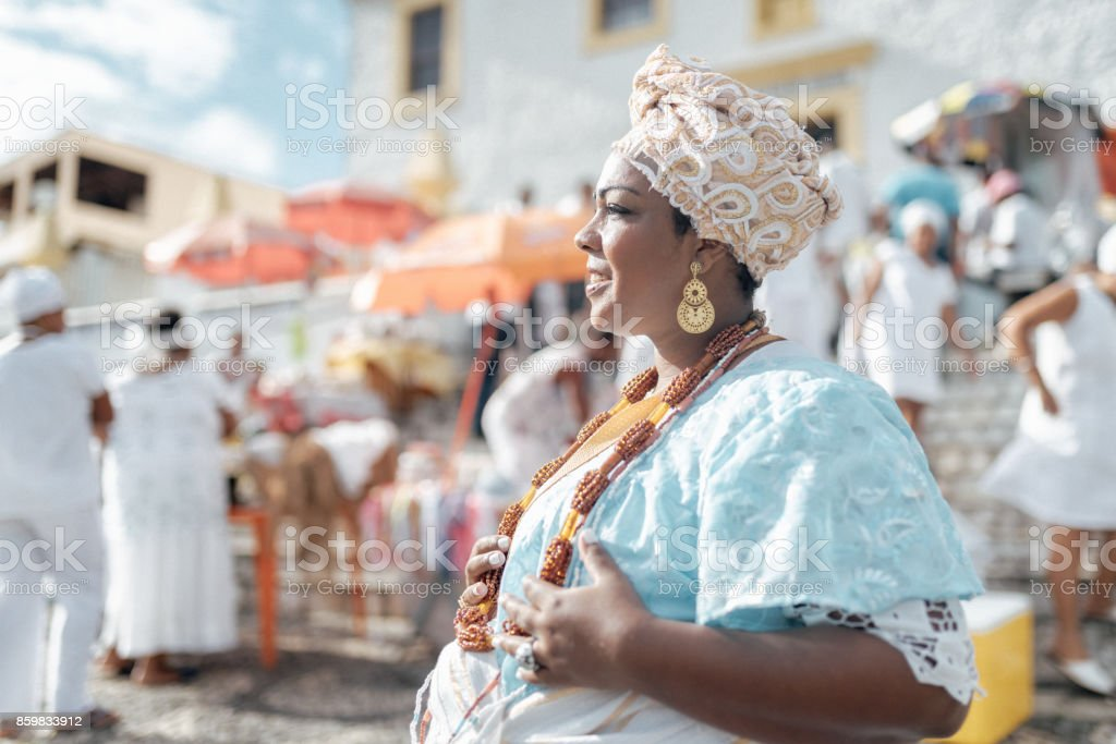 baiana in traditional costume in front of church in Salvador stock photo
