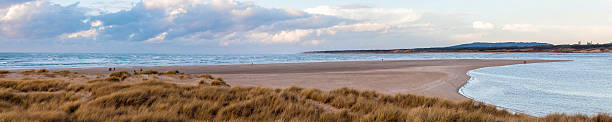 Baie de Somme, Le Touquet, France. Panoramic landscape of the estuary of La Somme, Le Touquet, Nord Pas de Calais, France. hauts de france stock pictures, royalty-free photos & images