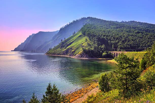 baikal landscape with an old railway bridge - siberië stockfoto's en -beelden