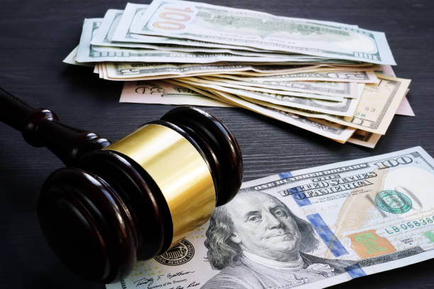 Bail bond and financial penalty. Gavel and money. stock photo