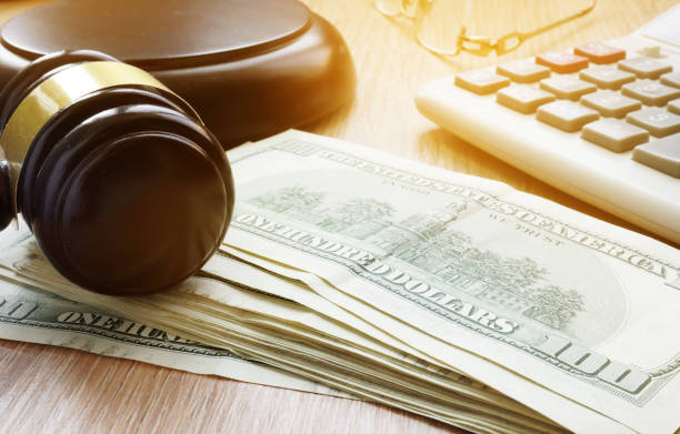 Bail bond concept. Gavel and dollar banknotes. stock photo