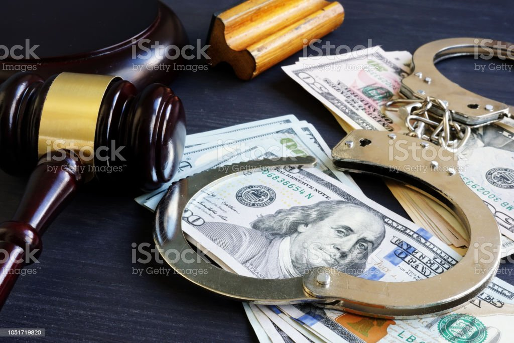 Bail bond. Corruption. Gavel, handcuffs and money. stock photo