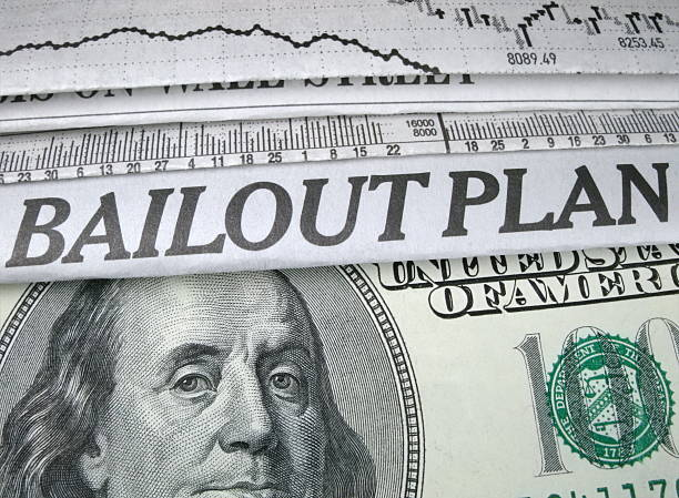 "Bailout Plan Newspaper headline ""Bailout Plan"" and currency bailout stock pictures, royalty-free photos & images"