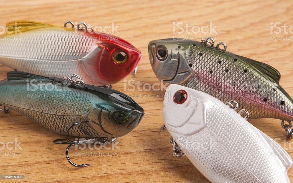 bait for fishing - wobbler on light wood royalty-free stock photo