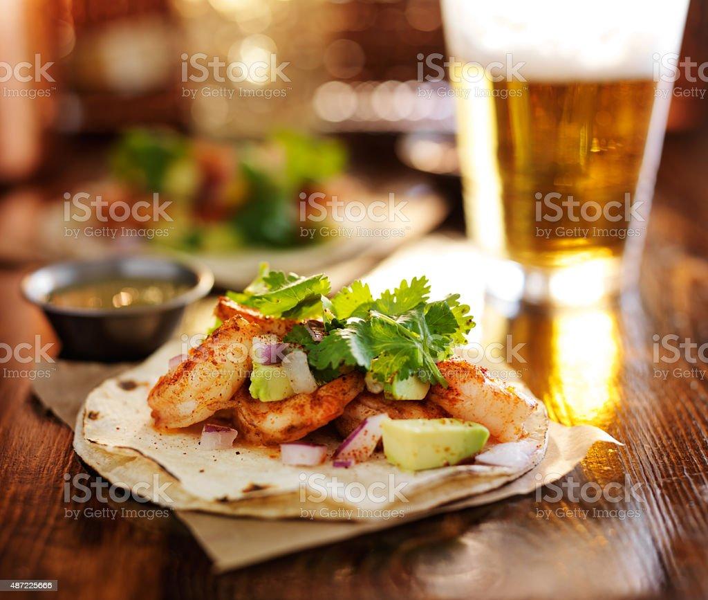 baja shrimp tacos with avocado stock photo