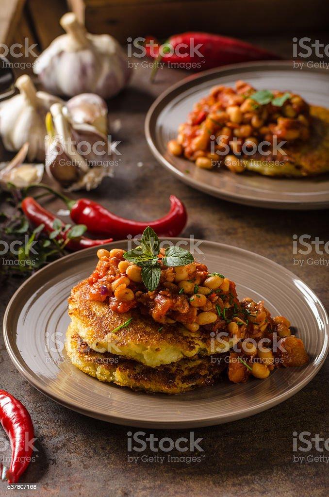 Bake beans with fluffly potato cakes stock photo
