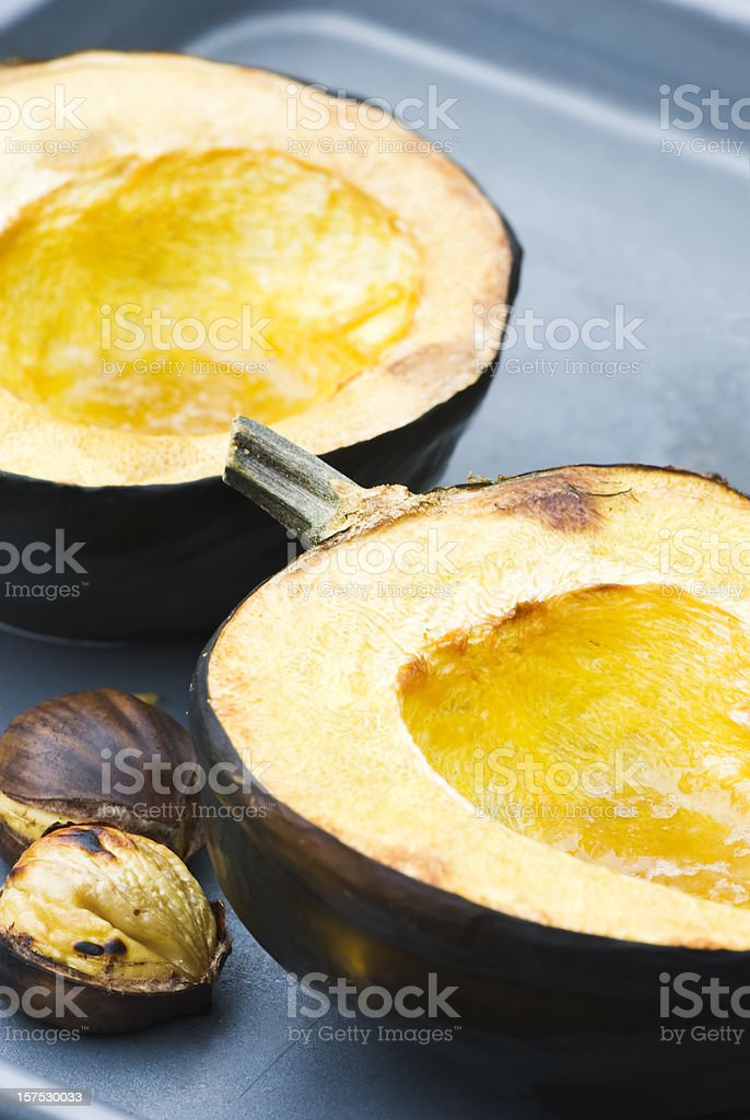 Baked Acorn (Winter) squash and Roasted Chestnuts royalty-free stock photo
