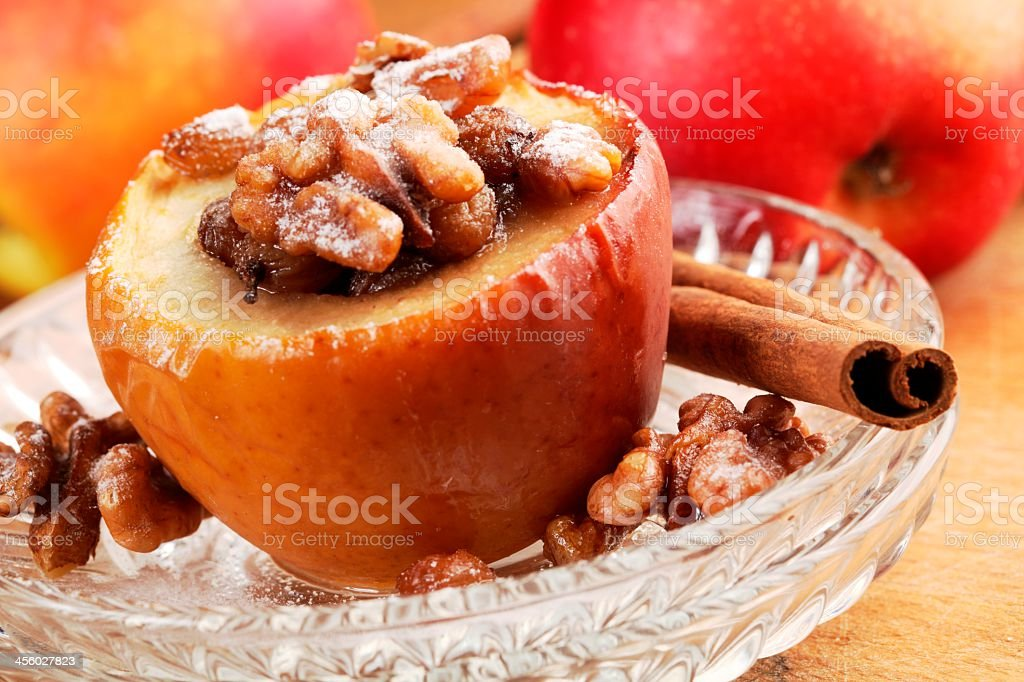 A baked and stuffed Apple on a dish stock photo