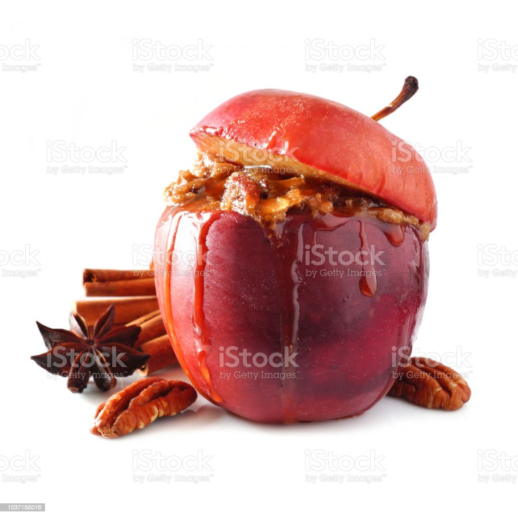 Baked apple with caramel, brown sugar and and nuts isolated on white stock photo