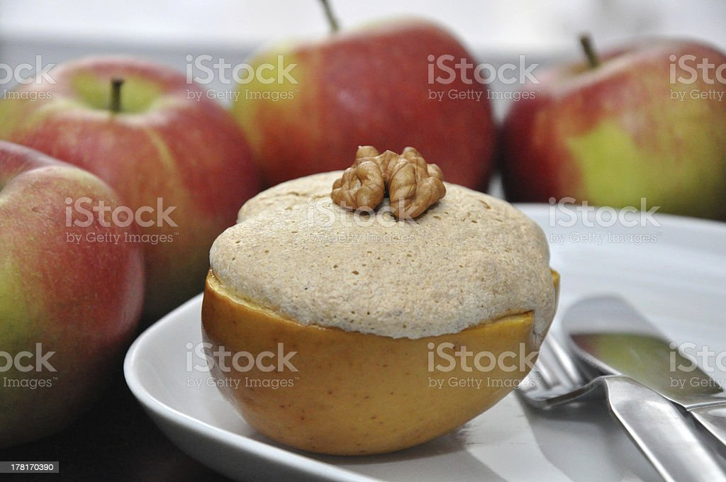 Baked apple with meringue and walnuts royalty-free stock photo