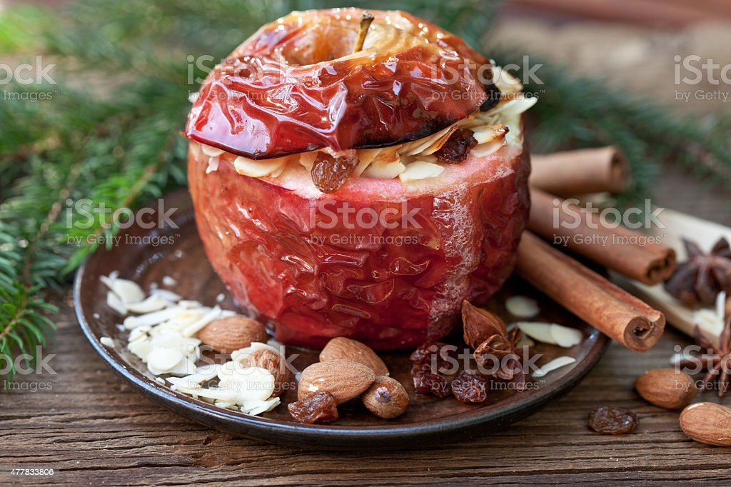 Baked apple with spices and fir branch stock photo
