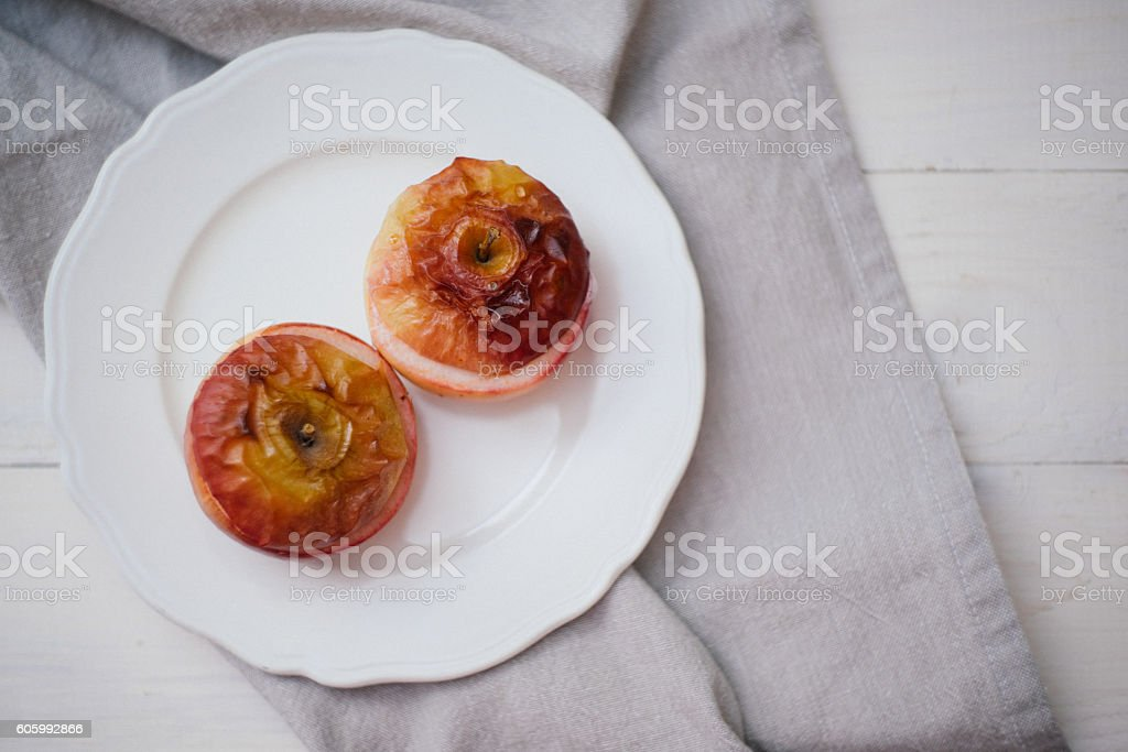 Baked apples on a white background stock photo