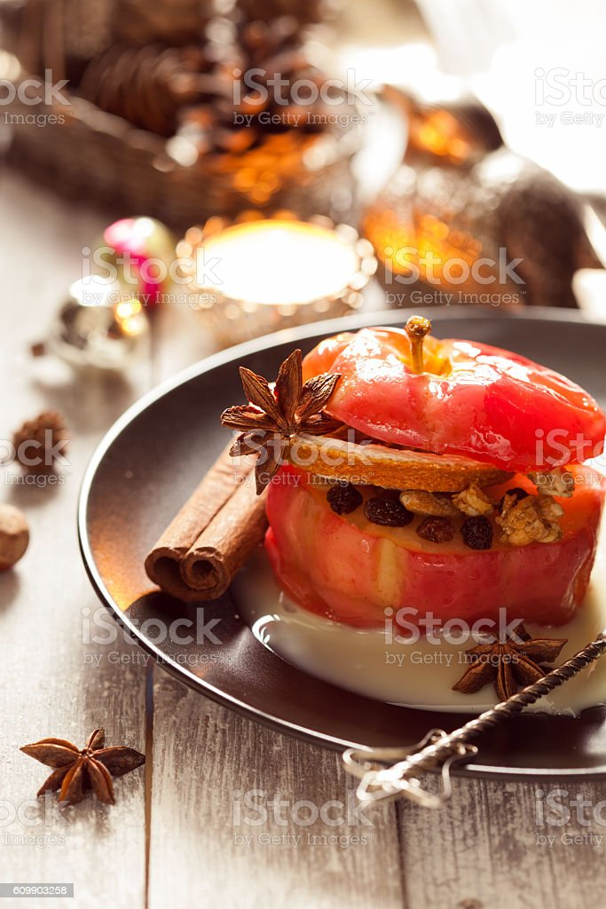Baked apples stuffed with cream honey and nuts stock photo