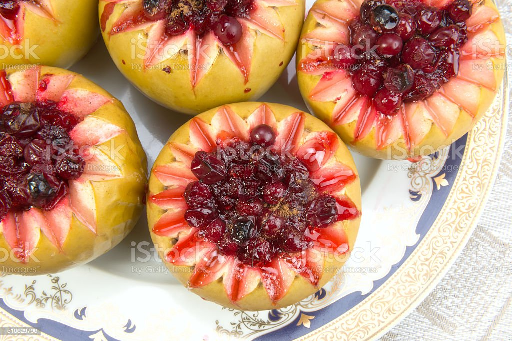 Baked apples with cranberry sauce stock photo