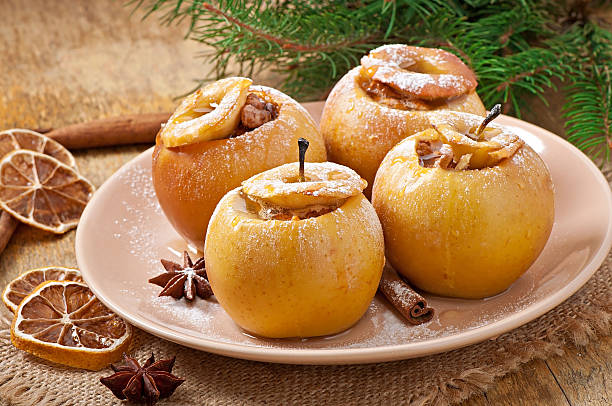 Baked apples with honey and nuts Baked apples with honey and nuts star anise stock pictures, royalty-free photos & images