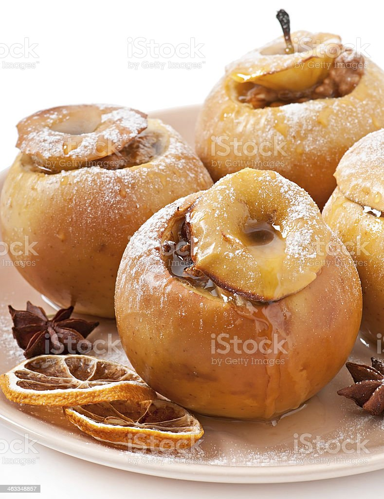 Baked apples with honey and nuts stock photo