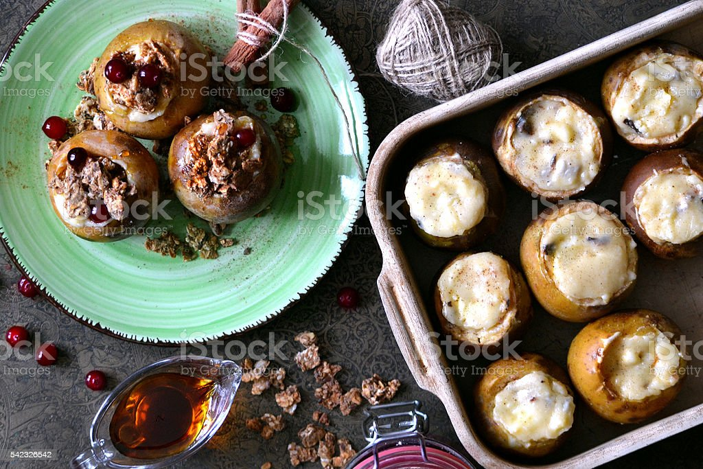 Baked apples with honey, nuts, berries and granola stock photo
