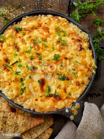 Baked Artichoke and Asiago Cheese Dip with Crispy Pita Chips