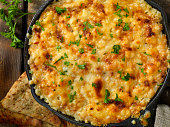 istock Baked Artichoke and Asiago Cheese Dip with Crispy Pita Chips 1190245273