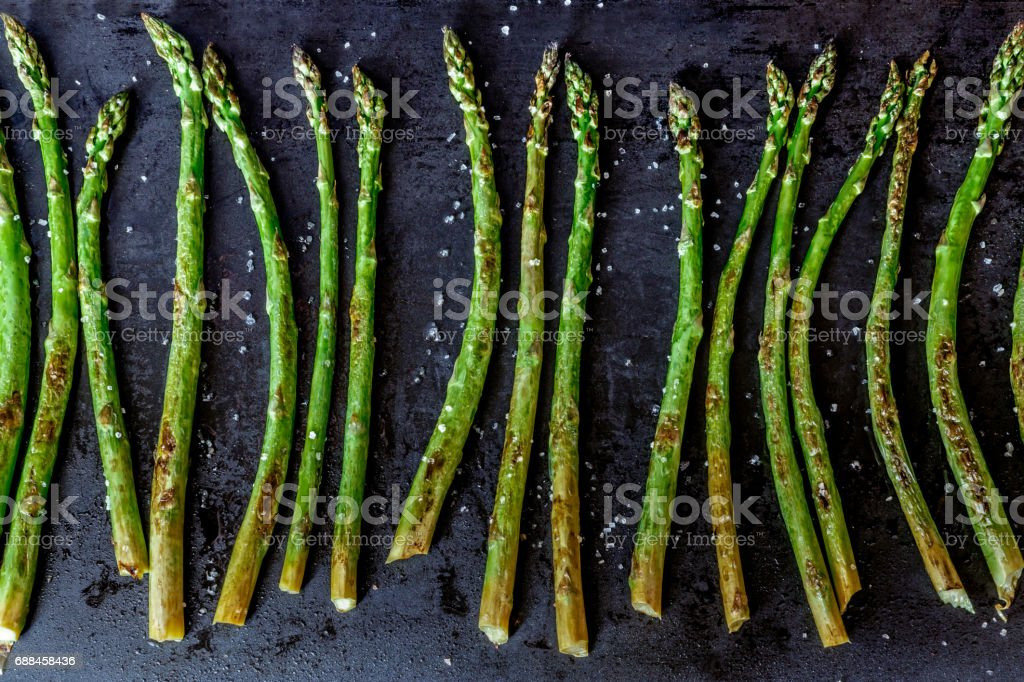 Baked asparagus on a dark background. royalty-free stock photo
