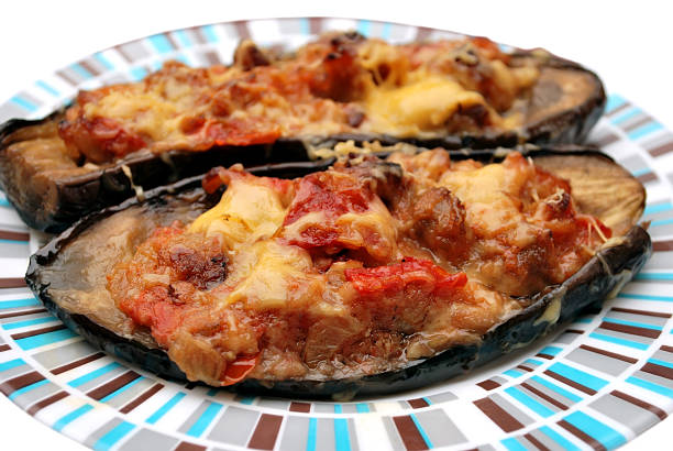 baked aubergine stuffed with vegetables and cheese stock photo