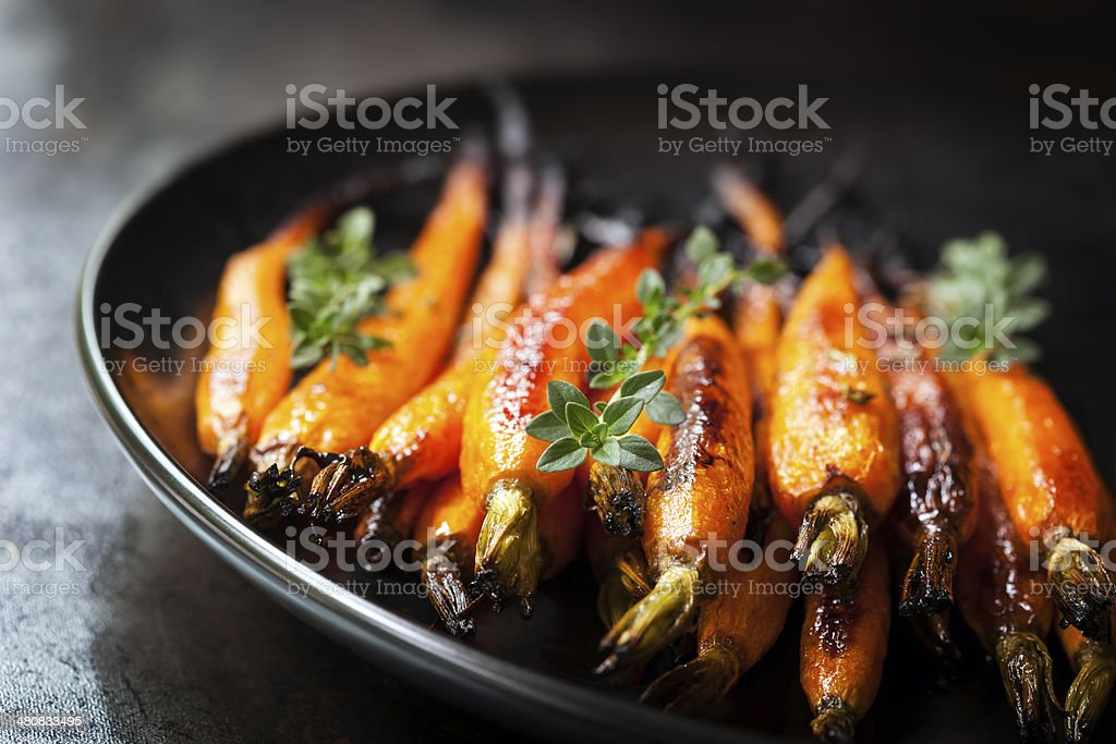 Baked Baby Carrots with Thyme stock photo