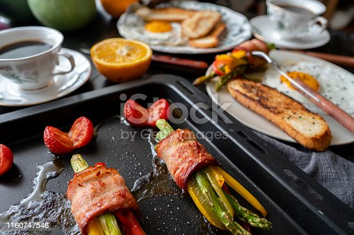 baked bacon roll with colorful bell pepper and asparagus