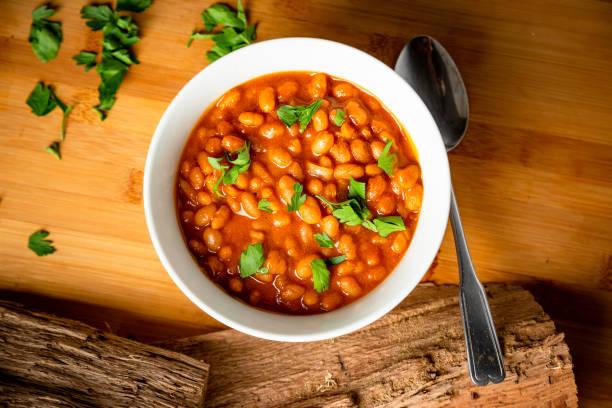 pieczone grill grill texas style beans na kolację lub lunch pozłacane food photography - fasola zdjęcia i obrazy z banku zdjęć