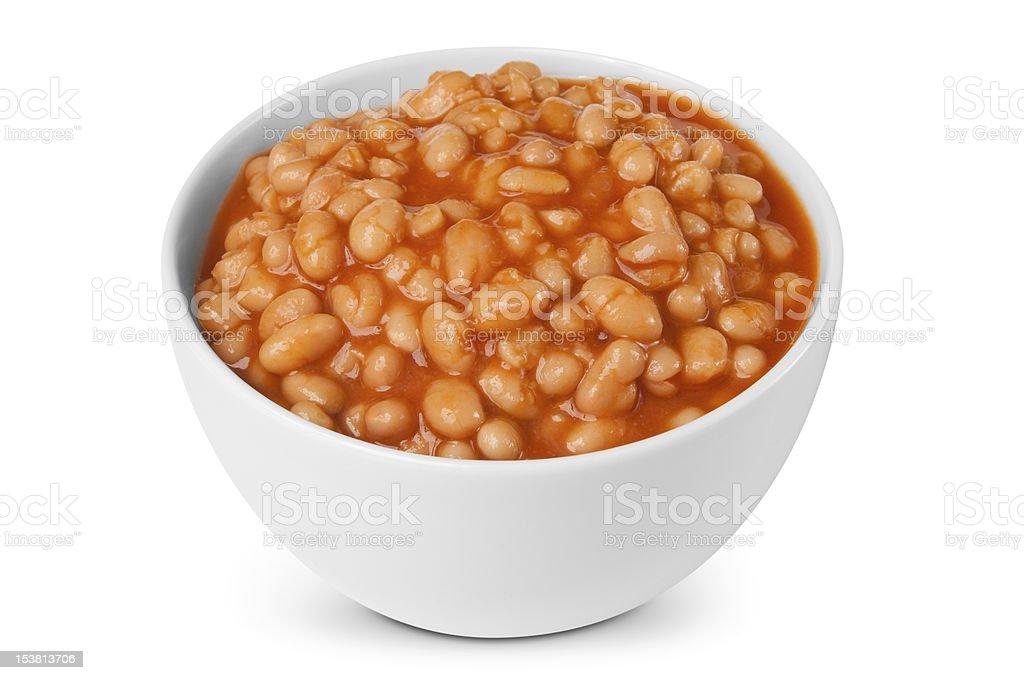 Baked beans in white bowl against white background stock photo