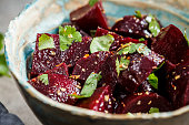 Baked beetroot salad with cilantro in a bowl. Healthy vegan food concept.