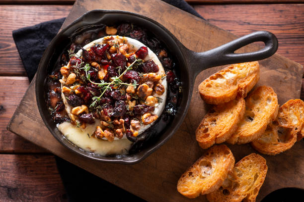 baked brie - baked brie stock photos and pictures