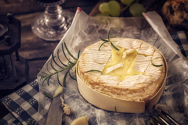 baked camembert cheese - baked brie stock photos and pictures