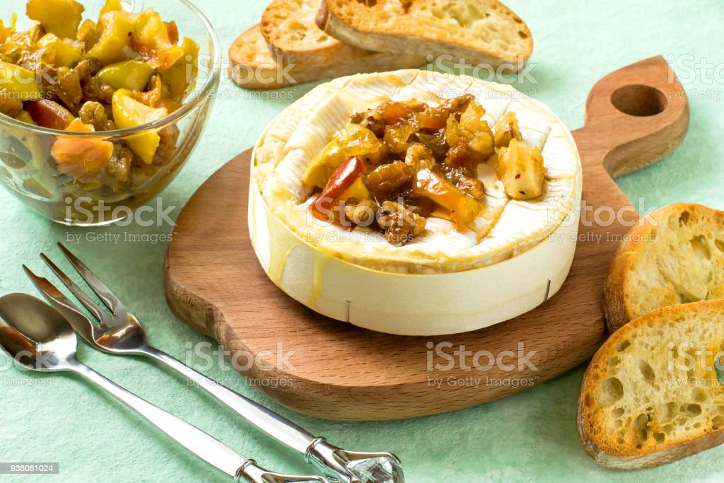 Baked camembert cheese with apple chutney stock photo