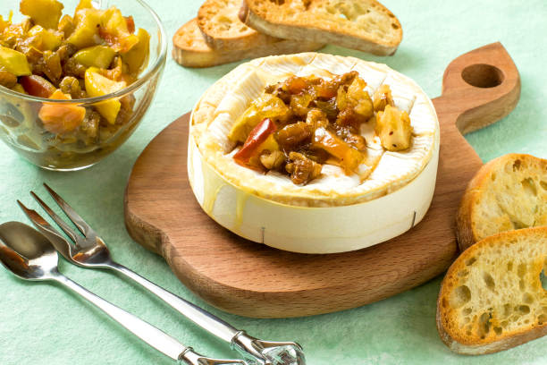 baked camembert cheese with apple chutney - baked brie stock photos and pictures