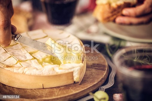 Baked Camembert cheese with garlic and rosemary. This soft, creamy and surface-ripened milk cheese is a delicious snack.