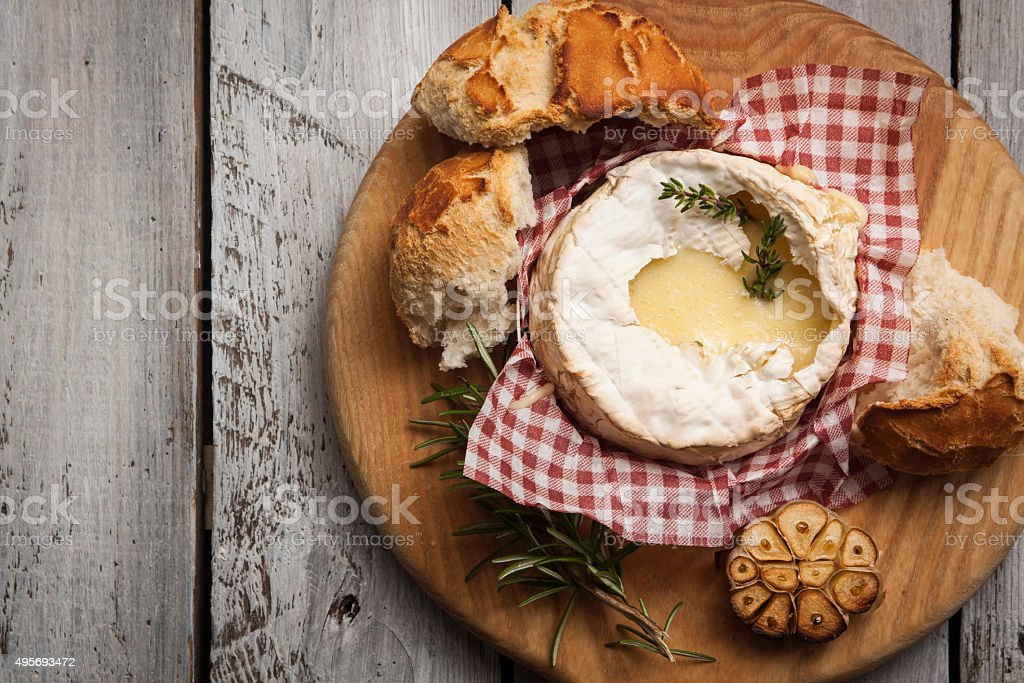Baked Camembert on Wood stock photo