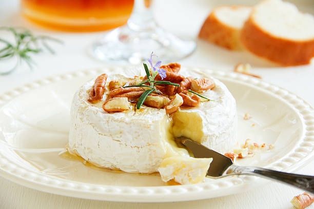 baked camembert with honey and pecans. - baked brie stock photos and pictures