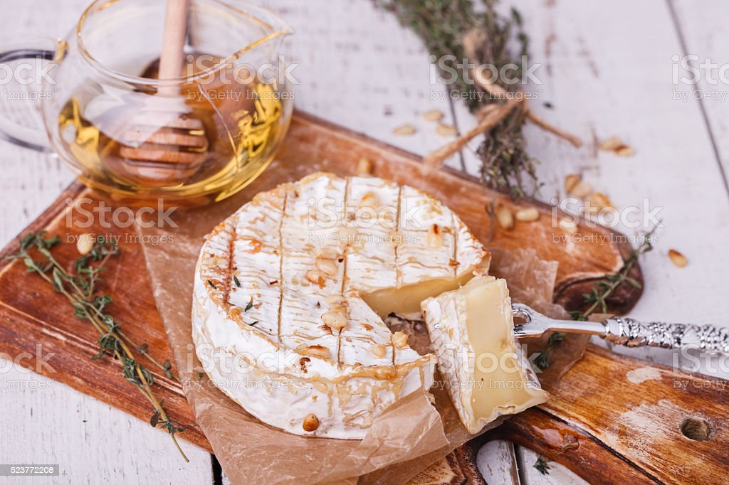 Baked Camembert with honey stock photo