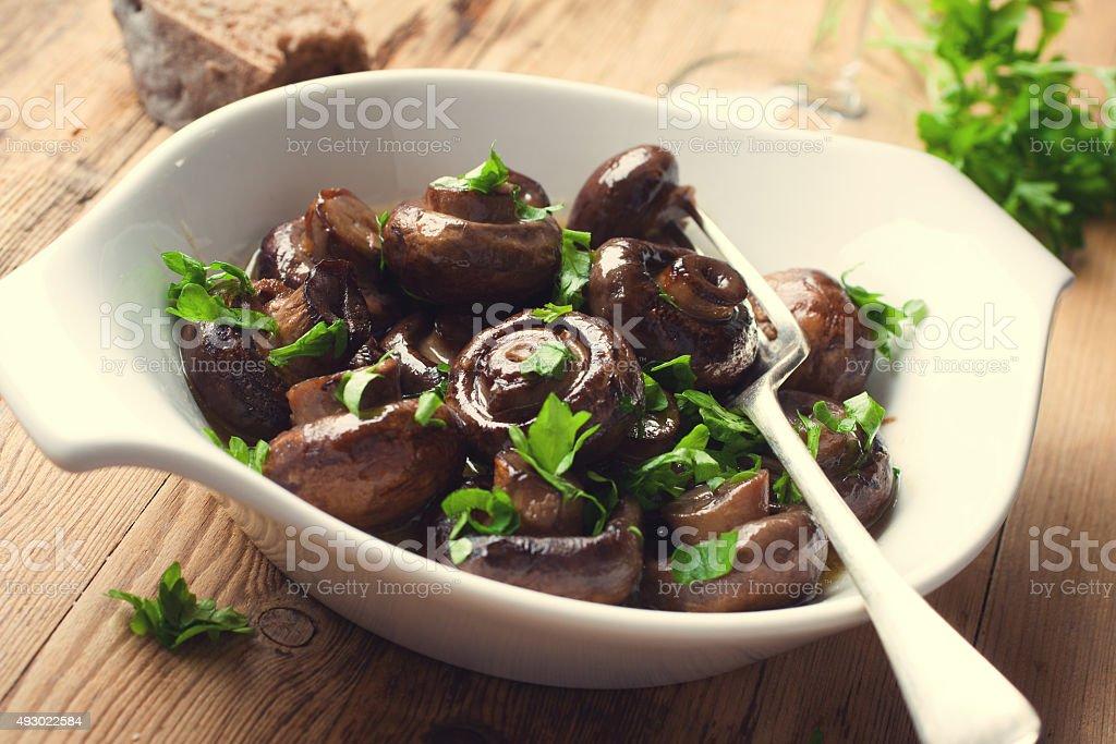 Baked champignons mushrooms stock photo