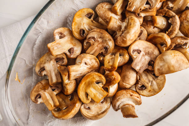Baked champignons with soy sauce, top view. stock photo