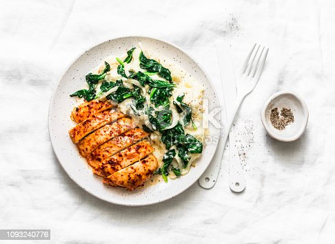 istock Baked chicken breast, mashed potatoes with creamy spinach on a light background, top view. Comfort food 1093240776