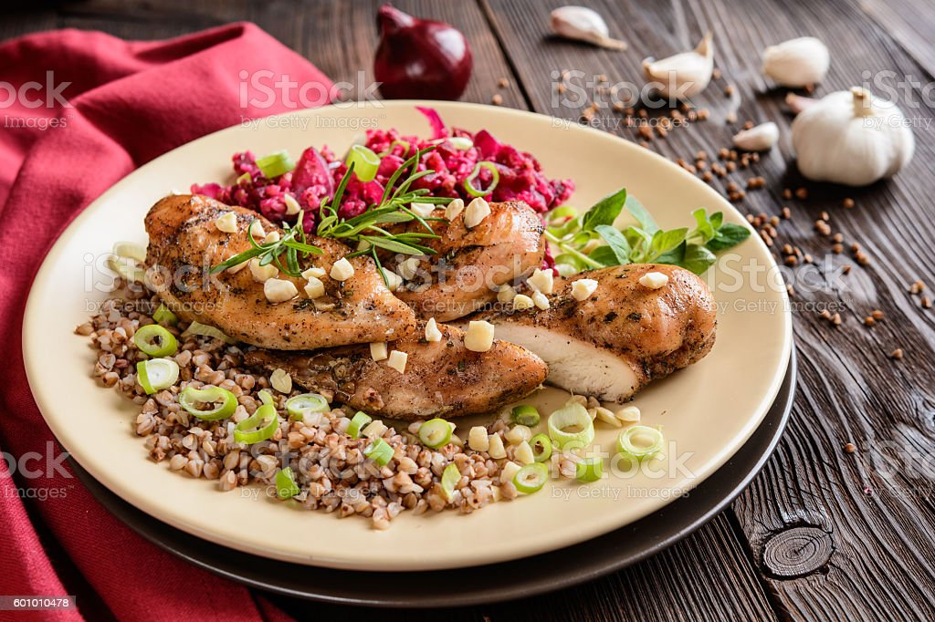 Baked chicken breast with buckwheat, beetroot and onion stock photo