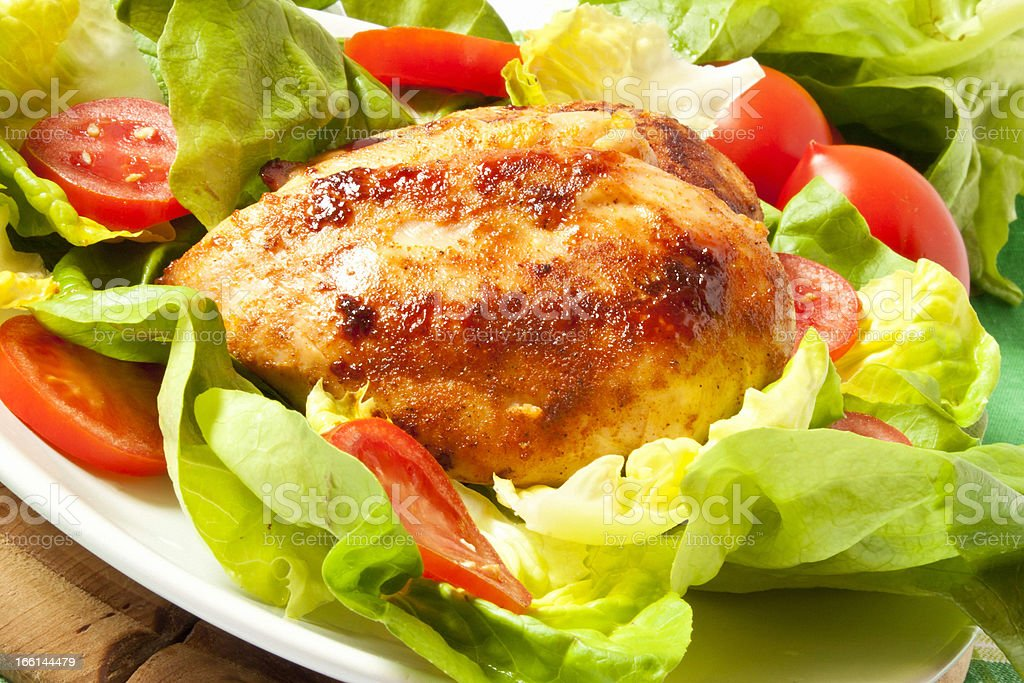 Baked chicken breast with salad royalty-free stock photo