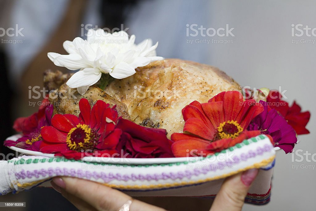 Baked chicken decorated with flowers royalty-free stock photo