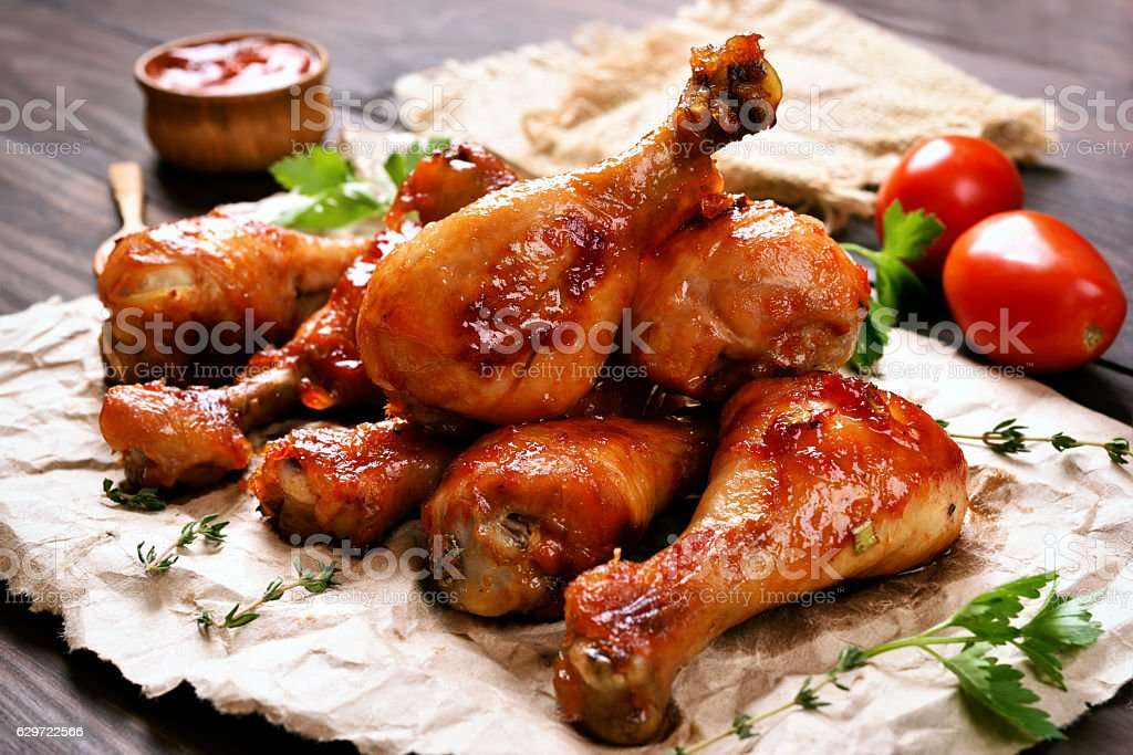 Baked chicken drumstick stock photo