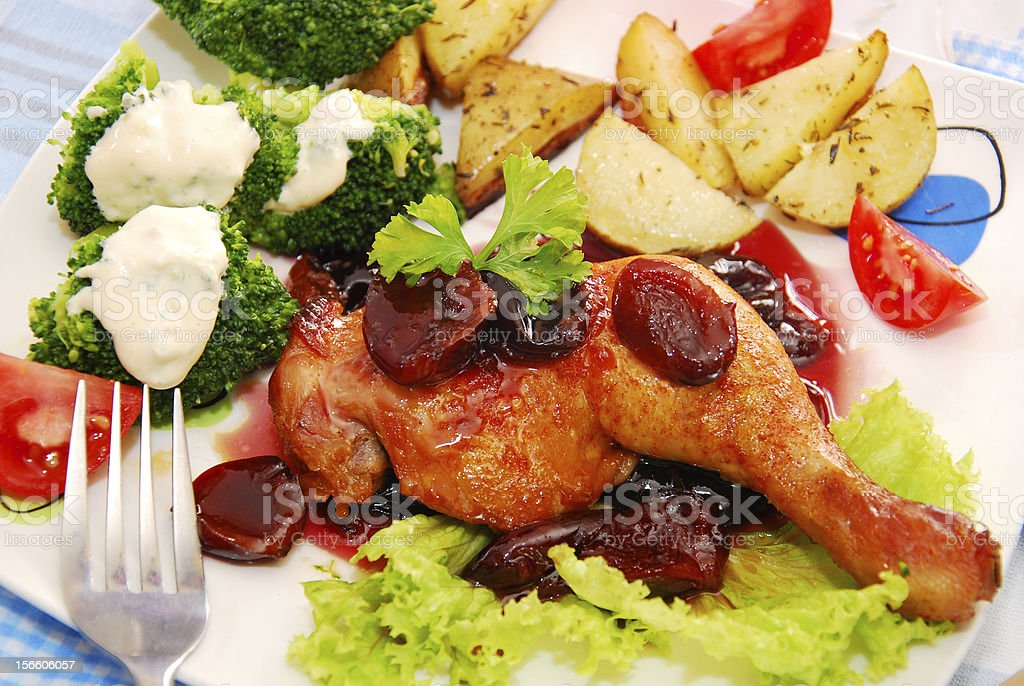 baked chicken leg in plum sauce royalty-free stock photo
